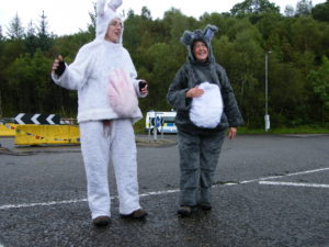 Jane and Penny dressed as rabbits leading singing outised Faslane Naval Base