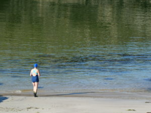 Swimer about to enter the sea